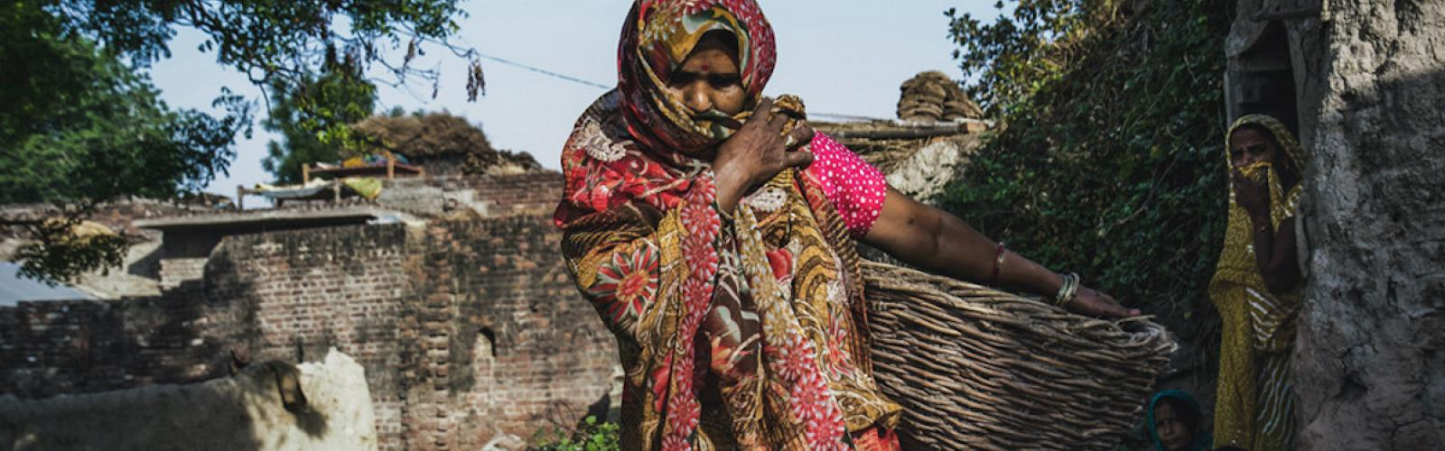 A woman in India covers her face during the coronavirus pandemic